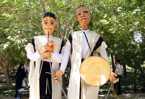 Tall Puppets in Iran Streets