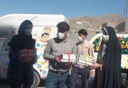 اهدای کتابهایی با روبان قرمز به کودکان نایسر